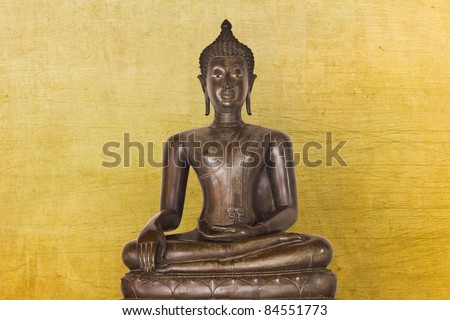 statue isolated on gold background