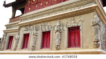 Statue near the holy angels, decorative wood window. buddhism-Phra-Singh.