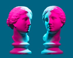 Statue neon. On a blue isolated background. Gypsum statue of Aphrodite's head.