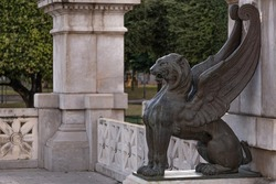 Statue of a black lion with wings made of bronze