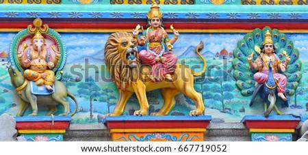 statue of a Hindu god, Durga devi, Kartikeya deva and Ganesha deva in front of hondu temple in Ho Chi Minh City, Vietnam