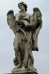 Statue of a huge angel on the bridge leading to the Castle of the Holy Angel (Castel Sant'Angelo); Rome, Italy, Europe