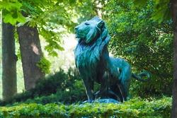 Statue of a lion, Luxembourg gardens in Paris, France. Le Lion de Nubie et sa Proie or Nubian Lion and his Prey statue by Auguste Cain