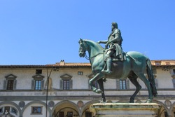 statue of a rider on a bronze horse in one of the squares in Florence