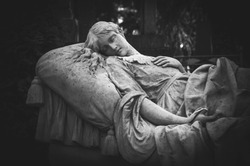 Statue of a sleeping angel in an old cemetery