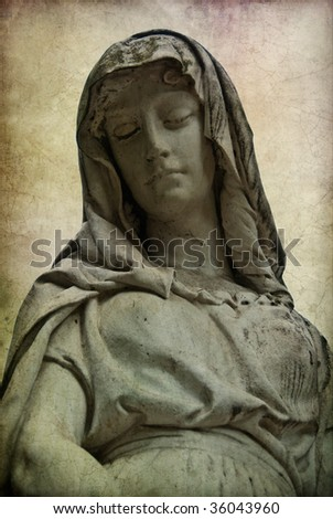 Statue of a woman at the Cimitero Monumentale at Milan, Italy