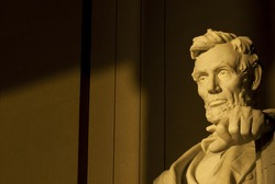 Statue of Abraham Lincoln in brilliant warm morning dramatic sunlight