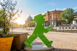 Statue of an ampelmann figure on the riverside in the old town of Berlin city