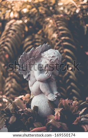 Statue of an angel in a garden