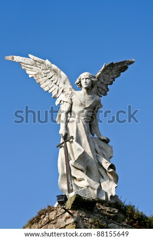 Statue of an angel made of stone from a cemetery in Cantabria, Spain.