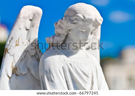 Statue of an angel with a blue sky background