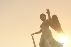 Statue of Angel before sunset