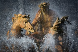 Statue of Apollo, his horses and chariot in a fountain at Versailles, France
