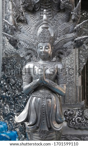 Statue of Bodhisattva of the Wat Sri Suphan Temple, known as the Silver Temple, in Chiang Mai, Thailand. Was built and decorated by silver handicraftsmen in 12 years. Stock photo ©