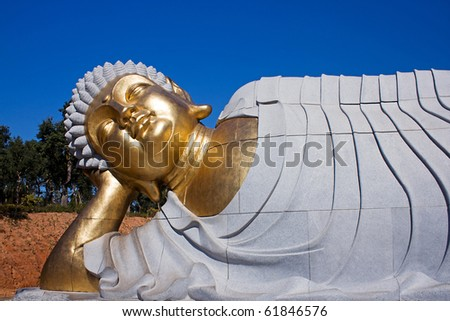 Statue of Buddha lying down - stock photo