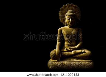 Statue of Buddha sitting in meditation With black space on the right hand side