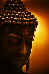 statue of budha in gold background