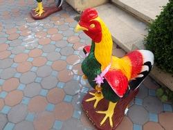 statue of chicken Animals on the ground