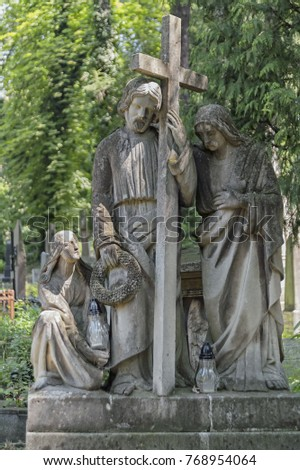 Statue of Christ Carrying the cross, decorating the Lychakiv Cemetery in Lviv, Ukraine #768954064
