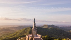 statue of Christ standing on a pedestal, The Balearic islands, Spain Palma de Mallorca, huge old statue on a hill during sunrise early in the morning