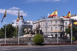 Statue of Cibeles, decorated with the flags of Spain and House of America of the background