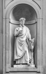 Statue of Dante Alighieri in the niches of the Uffizi Gallery colonnade, Florence.