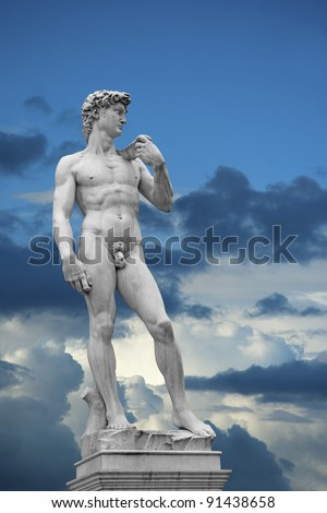 Statue of David on blue sky with white clouds. Copy of original in Florence, Italy