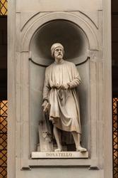 Statue of Donatello outside the Uffizi Gallery colonnade, Florence.