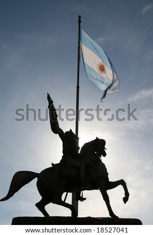 Statue of Dr. Manuel Belgrano (1770-1820), Argentinian hero, and Argentinian flag on the Plaza De Mayo in Buenos Aires