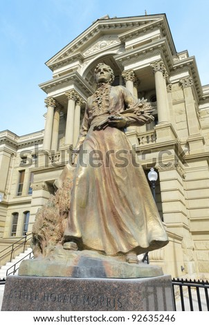 Statue of Esther Hobart Morris, the first female Justice of the Peace in the United States in front of the Wyoming State Capitol Building