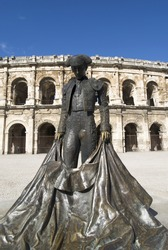 Statue of famous bullfighter in front of the arena in Nimes, France
