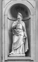 Statue of Francesco Petrarca in the niches of the Uffizi Gallery colonnade, Florence.