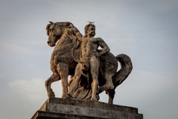 Statue of Gallic rider on the left bank of Pont d'Iéna (Jena Bridge) in Paris. Limestone sculpture by Antoine-Augustin Préault, installed in 1853.