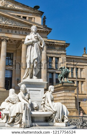 Statue of Germany poet Schiller in front of the Konzerthaus or Concert Hall in Berlin, Germany.