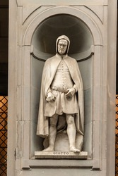 Statue of Giotto outside the Uffizi Gallery colonnade, Florence.