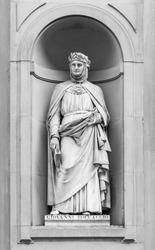Statue of Giovanni Boccaccio in the niches of the Uffizi Gallery colonnade, Florence.