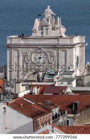 Statue of Glory rewarding Valor and Genius on the Rua Augusta Arch in Lisbon, Portugal, a symbol of the city's recovery from the 1755 earthquake, sculpted by Celestin Anatole Calmels in 1875. #777299566
