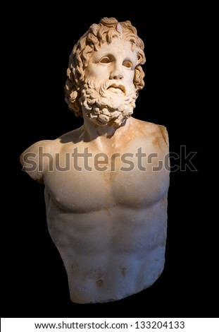 Statue of god Asclepius with selective lighting, black background