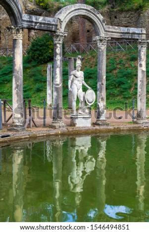 Statue of God Mars at the side of pool named Canopus in Hadrian's Villa (Villa Adriana) in Tivoli, Italy. #1546494851