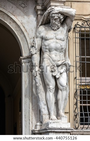 Statue of Hercules at the entrance to the 18th century Palazzo Vescovile (Bishops Palace) in the historical center of Mantua, Italy #440755126