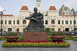 Statue of Ho Chi Minh and Peoples Committee Building, Saigon, Vietnam. Image by Kevin Hellon