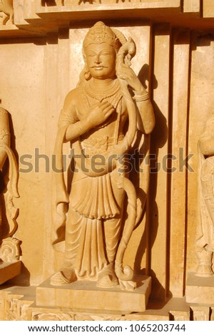 statue of Indian god made from stone carving on Indian temple #1065203744