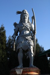 Statue of Indian god. This is the statue of lord shiva who is in the form of hunter. Statue Location - Chardham temple,Namchi,Sikkim,India.