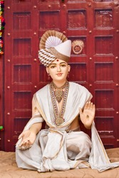Statue of Indian Lord Swaminarayan blessing wallpaper design