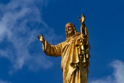 Statue of Jesus Christ against the background of the blue sky. Basilica of Our Lady of the Rosary, Sanctuary of Fatima, Portugal.