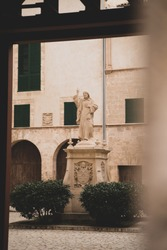 Statue of Jesus Christ next to cathedral of Palma de Mallorca on Spanish island. His hand is raised in a blessing gesture.