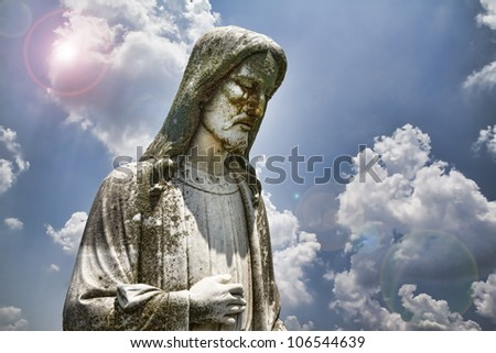 Statue of Jesus Christ with sky background/Jesus Christ the Light of the World/Statue of the Lord Jesus Christ with cloudy blue sky and sun flares