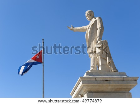 Statue of Jose Marti, Cienfuegos and Cuban flag, Cuba