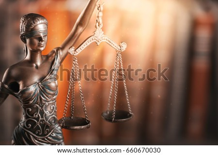 Statue of justice and book.