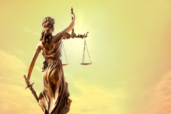 Statue of justice. Close-up Of Justice Lady Against Abstract nature background, blurred Sunset sky at twilight time.